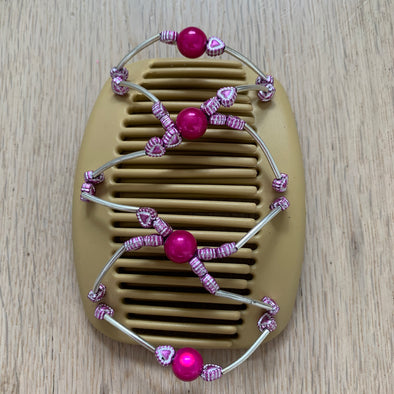Medium blonde hair comb with metallic beading, large pink centre beads and pink heart beads.