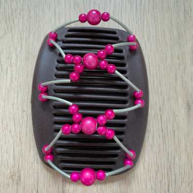 Medium brown hair clip with metallic outer beading and pink centre beads