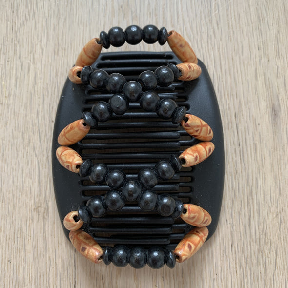 Medium black hair comb with orange patterned outer beads and black centre beads
