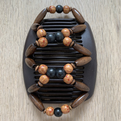Medium brown hair clip with black, dark brown wooden and patterned beads.
