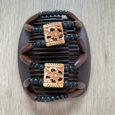 Medium brown hair clip with black and brown beads, and light decorative centre beads.