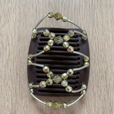 Fine brown hair clip with gold diamond shaped beads and golden beads