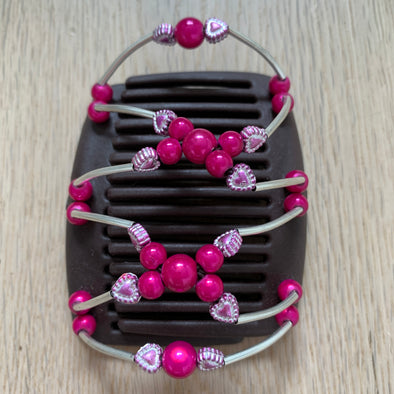 Fine brown hair comb with pink centre beads and metallic pale pink hearts
