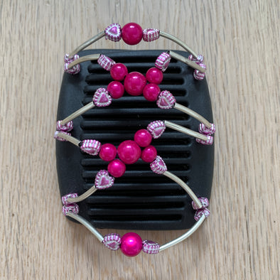 Fine black hair comb with pink centre beads and metallic pale pink hearts