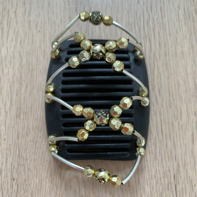 Fine black hair comb with gold rose-shaped centre beads and gold beads