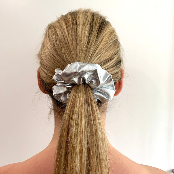 Scrunchies are back and they're here to stay! These stunning scrunchies look great in your hair and also work as gorgeous accessories.  Colour/Pattern: Shiny silver Material: Lycra (medium weight) Washing instructions: Cold hand wash  Dimensions: Material width approximately 4 cm  Made by us in Bondi Beach  With love from Larzy xx