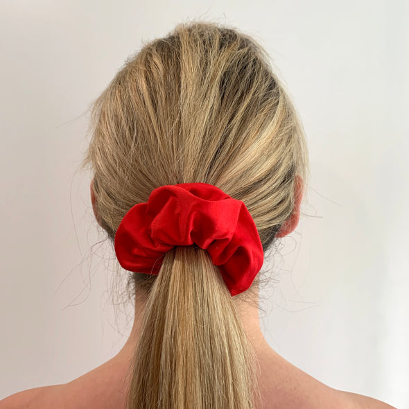 Scrunchies are back and they're here to stay! These stunning scrunchies look great in your hair and also work as gorgeous accessories.  Colour/Pattern: Red Material: Cotton  Washing instructions: Cold hand wash  Dimensions: Material width approximately 4 cm  Made by us in Bondi Beach  With love from Larzy xx