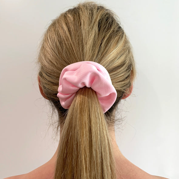 Scrunchies are back and they're here to stay! These stunning scrunchies look great in your hair and also work as gorgeous accessories.  Colour/Pattern: Pale Pink Material: Lycra Washing instructions: Cold hand wash  Dimensions: Material width approximately 4 cm  Made by us in Bondi Beach  With love from Larzy xx