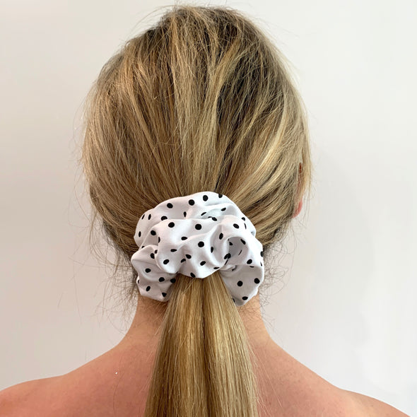 Scrunchies are back and they're here to stay! These stunning scrunchies look great in your hair and also work as gorgeous accessories.  Colour/Pattern: White with black polka dots Material: Polyester  Washing instructions: Cold hand wash  Dimensions: Material width approximately 4 cm  Made by us in Bondi Beach  With love from Larzy xx