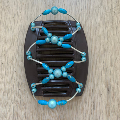 Large brown hair clip with blue beads