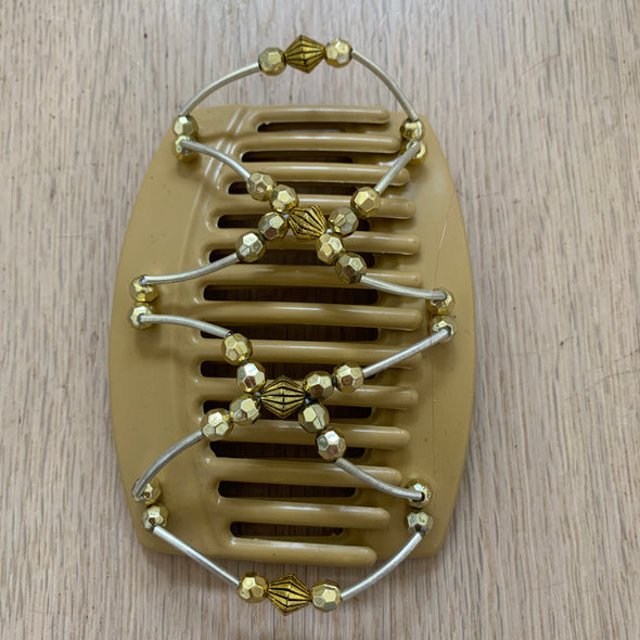 Large blonde hair comb with gold beads