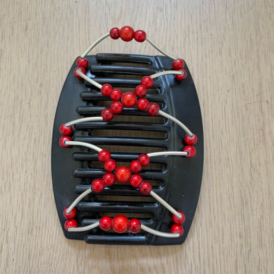 Large black hair comb with red beads