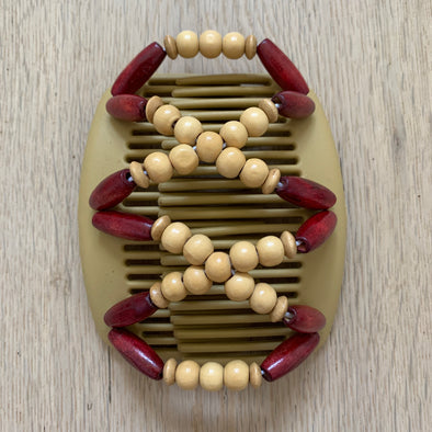 Medium blonde hair clip with red and light brown wooden beads.