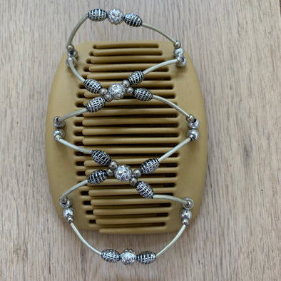 Medium blonde hair clip with metallic and silver decorative beads.
