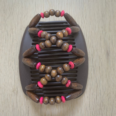 Medium brown hair clip with dark wooden beads and pink outer beads.