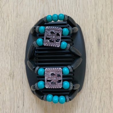 Medium black hair clip with decorative beaded centre, and black and turquoise outer beading.