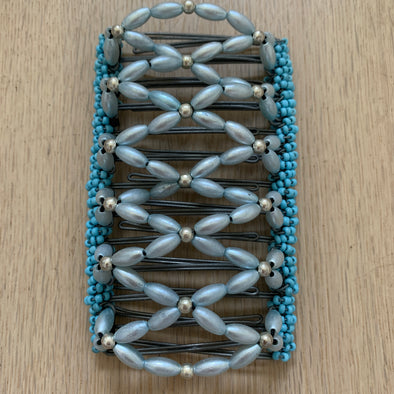 Gorgeous African Butterfly clip for those with thick hair to be used for up-styles or half up-styles.   Wire comb is silver in colour with blue beading. Beads are threaded on an elastic and attached to each comb, making it super easy to put on and remove.  Measurements; length - 12 cm, width - 7.5 cm