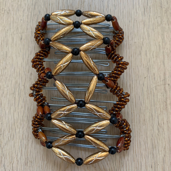 Large wire hair comb with shiny gold and black coloured beads.