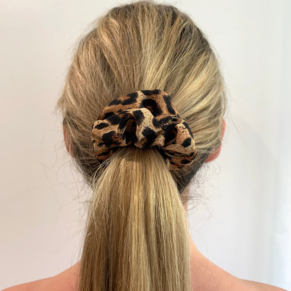 Scrunchies are back and they're here to stay! These stunning scrunchies look great in your hair and also work as gorgeous accessories.  Colour/Pattern: Leopard print Material: Polyester Washing instructions: Cold hand wash  Dimensions: Material width approximately 4 cm  Made by us in Bondi Beach  With love from Larzy xx