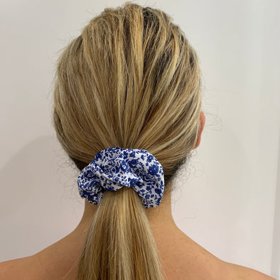 Scrunchies are back and they're here to stay! These stunning scrunchies look great in your hair and also work as gorgeous accessories.  Colour/Pattern: White with blue flowers  Material: Cotton Poly Poplin  Washing instructions: Cold hand wash  Dimensions: Material width approximately 4 cm  Made by us in Bondi Beach  With love from Larzy xx