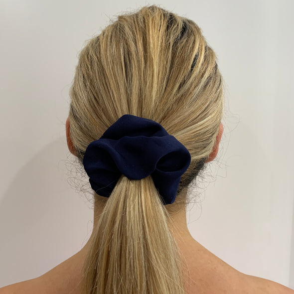 Scrunchies are back and they're here to stay! These stunning scrunchies look great in your hair and also work as gorgeous accessories.  Colour/Pattern: Navy Material: Polyester Washing instructions: Cold hand wash  Dimensions: Material width approximately 4 cm  Made by us in Bondi Beach  With love from Larzy xx
