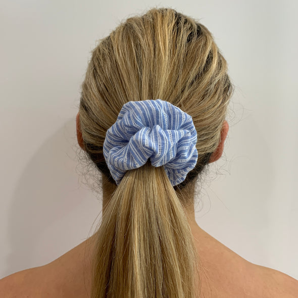 Scrunchies are back and they're here to stay! These stunning scrunchies look great in your hair and also work as gorgeous accessories.  Colour/Pattern: White and blue striped  Material: Cotton  Washing instructions: Cold hand wash  Dimensions: Material width approximately 4 cm  Made by us in Bondi Beach  With love from Larzy xx