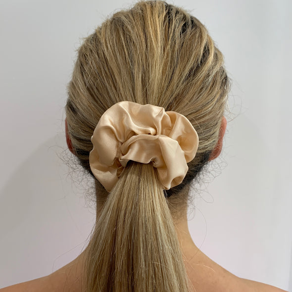 Scrunchies are back and they're here to stay! These stunning scrunchies look great in your hair and also work as gorgeous accessories.  Colour/Pattern: Champagne Material: Satin Washing instructions: Cold hand wash  Dimensions: Material width approximately 4 cm  Made by us in Bondi Beach  With love from Larzy xx