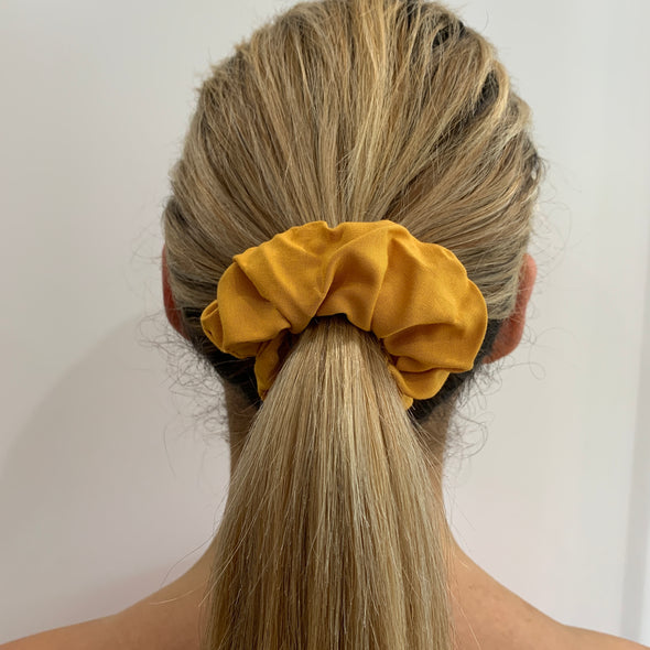 Scrunchies are back and they're here to stay! These stunning scrunchies look great in your hair and also work as gorgeous accessories.  Colour/Pattern: Mustard Yellow Material: Cotton  Washing instructions: Cold hand wash  Dimensions: Material width approximately 4 cm  Made by us in Bondi Beach  With love from Larzy xx