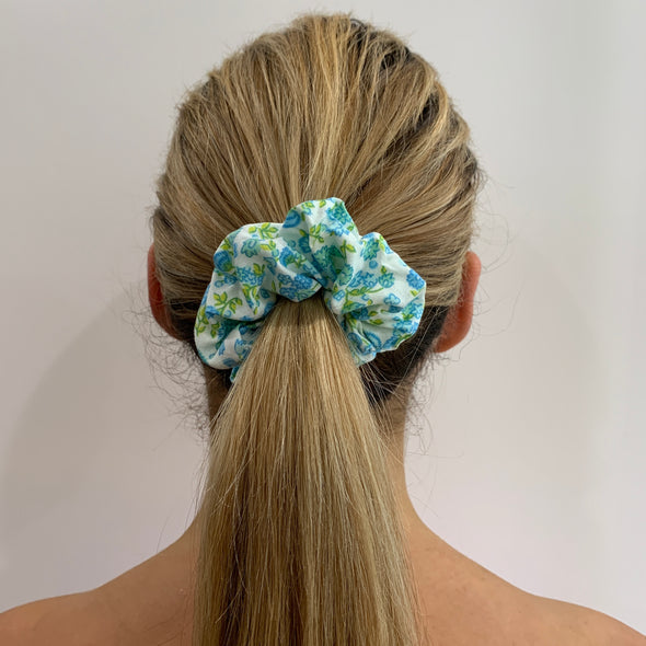 Scrunchies are back and they're here to stay! These stunning scrunchies look great in your hair and also work as gorgeous accessories.  Colour/Pattern: White with blue and yellow flowers  Material: Cotton  Washing instructions: Cold hand wash  Dimensions: Material width approximately 4 cm  Made by us in Bondi Beach  With love from Larzy xx