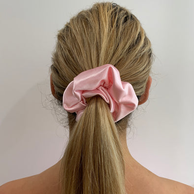 Scrunchies are back and they're here to stay! These stunning scrunchies look great in your hair and also work as gorgeous accessories.  Colour/Pattern: Baby Pink Material: Satin  Washing instructions: Cold hand wash  Dimensions: Material width approximately 4 cm  Made by us in Bondi Beach  With love from Larzy xx