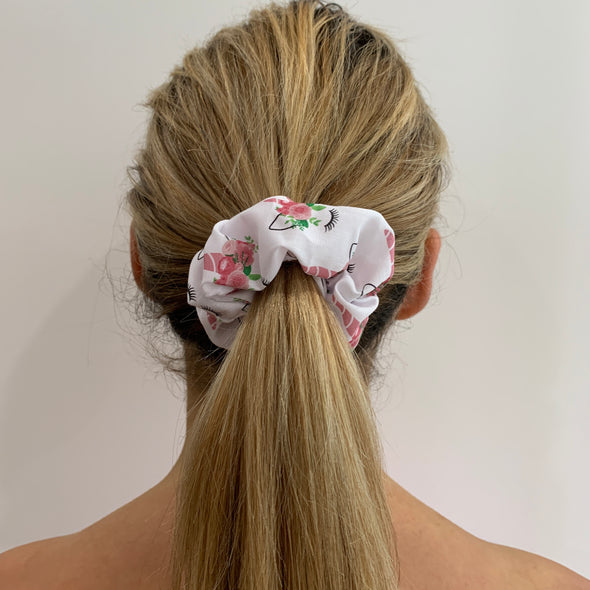 Scrunchies are back and they're here to stay! These stunning scrunchies look great in your hair and also work as gorgeous accessories.  Colour/Pattern: White with sleeping unicorn faces Material: Cotton Poly Poplin blend  Washing instructions: Cold hand wash  Dimensions: Material width approximately 4 cm  Made by us in Bondi Beach  With love from Larzy xx