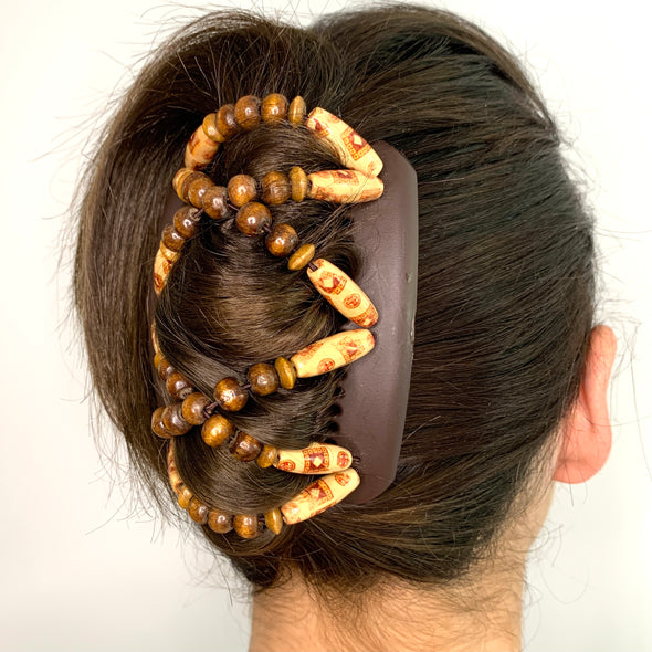 Medium brown hair clip with dark wooden beads and silver outer beads.