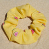 Scrunchies are back and they're here to stay! These stunning scrunchies look great in your hair and also work as gorgeous accessories.  Colour/Pattern: Yellow with watermelons  Material: Cotton Polyester blend  Washing instructions: Cold hand wash  Dimensions: Material width approximately 4 cm  Made by us in Bondi Beach  With love from Larzy xx