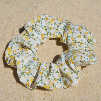 white scrunchie with yellow flowers