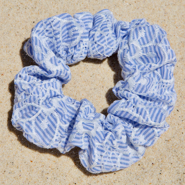 light blue with white flower pattern scrunchie