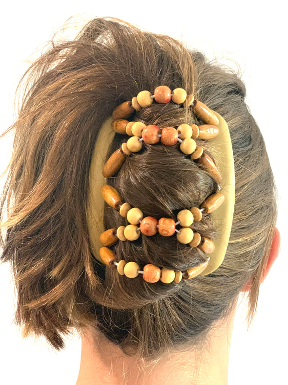 Medium blonde hair comb with natural wooden beading, purple outer beads and large, stripy brown centre beads.