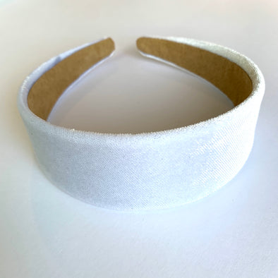 Gorgeous white velvet headband that sits flat on the head  4cm at the widest part (sits at the top of the head)  Care: Use clean damp cloth  Imported