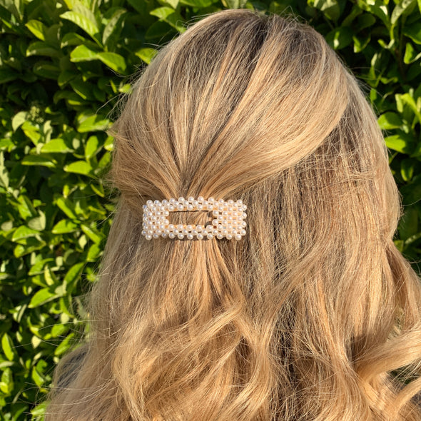 small rectangle shaped hair clip with gold coloured base