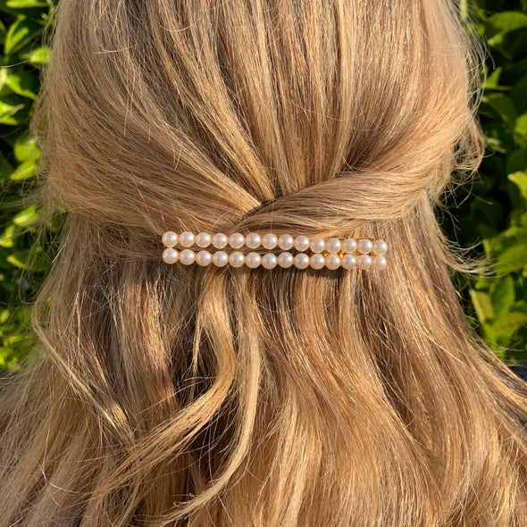 28 faux pearls set in 2 lines