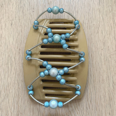 Large blonde hair clip with blue beads