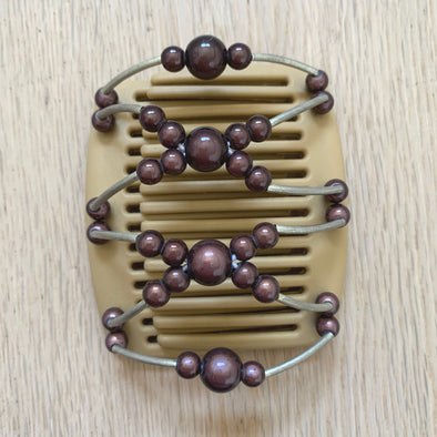 Fine blonde hair comb with brown beads