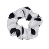 Scrunchies are back and they're here to stay! These stunning scrunchies look great in your hair and also work as gorgeous accessories.  Colour/Pattern: White with large black spots  Material: Satin Polyester blend  Washing instructions: Cold hand wash  Dimensions: Material width approximately 4 cm  Made by us in Bondi Beach  With love from Larzy xx