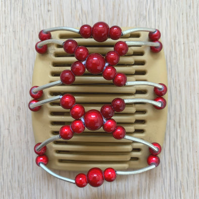 Fine blonde hair comb with red beads
