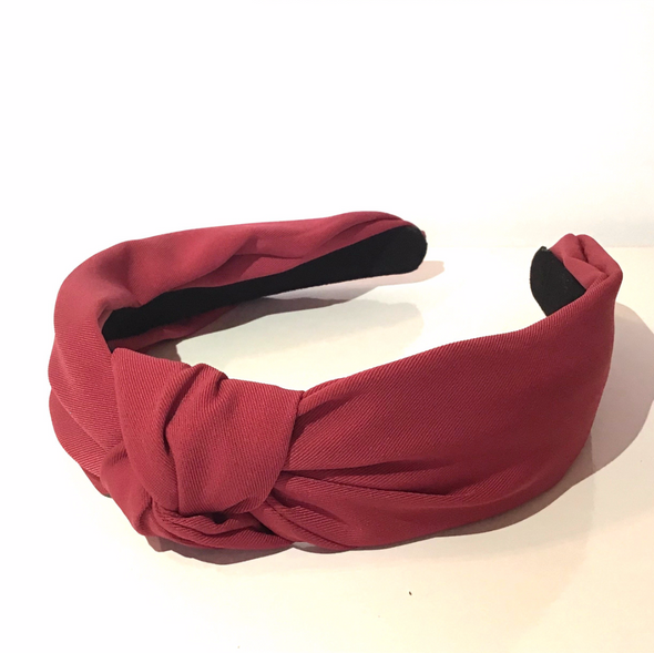 Gorgeous soft, super comfortable fabric headband in red with top knot. Inside of headband is lined with suede-like material.  Colours available: Black, Brown (Tan colour), Khaki, Dark Green, Blue (similar to Pantone's Zen Blue), Navy, Mustard (Yellow), Dusty Pink and Red (deep red not bright red!)  Care: Use clean damp cloth  Origin: Imported