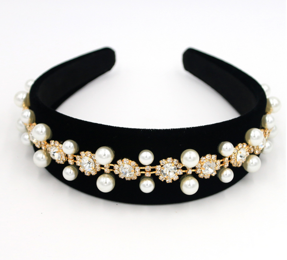 Stunning baroque-style black velvet material headband with pearl and diamonte beading.   Suede feel interior.  Super comfortable fit around head - doesn't dig in behind ears.  Perfect finish for special occasions.  Origin: Imported