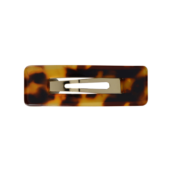 Tortoiseshell rectangle hair clip set on gold toned base.