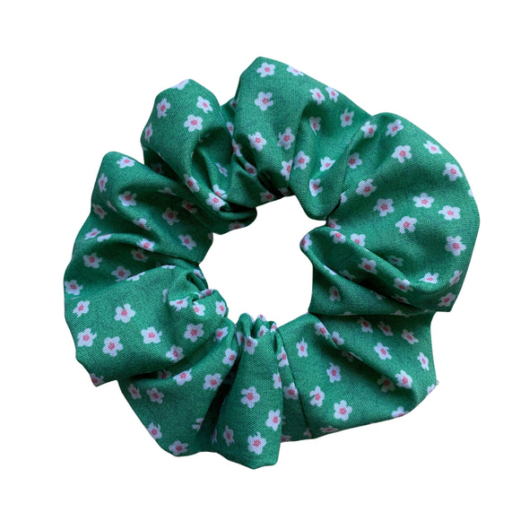 Scrunchies are back and they're here to stay! These stunning scrunchies look great in your hair and also work as gorgeous accessories.  Colour/Pattern: Green with white flowers Material: Cotton Polyester blend Washing instructions: Cold hand wash  Dimensions: Material width approximately 4 cm  Made by us in Bondi Beach  With love from Larzy xx