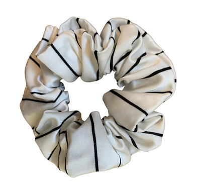 Scrunchies are back and they're here to stay! These stunning scrunchies look great in your hair and also work as gorgeous accessories.  Colour/Pattern: White with black stripes  Material: Viscose  Washing instructions: Cold hand wash  Dimensions: Material width approximately 4 cm  Made by us in Bondi Beach  With love from Larzy xx