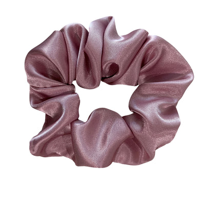 Scrunchies are back and they're here to stay! These stunning scrunchies look great in your hair and also work as gorgeous accessories.  Colour/Pattern: Dusty Pink Material: Satin  Washing instructions: Cold hand wash  Dimensions: Material width approximately 5 cm  Made by us in Bondi Beach  With love from Larzy xx