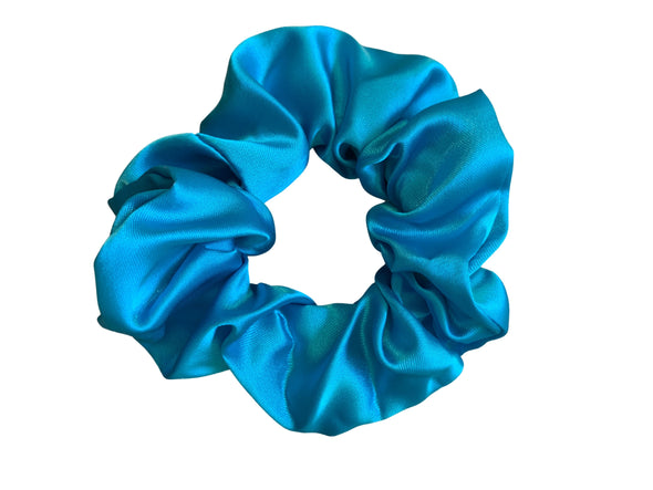 Scrunchies are back and they're here to stay! These stunning scrunchies look great in your hair and also work as gorgeous accessories.  Colour/Pattern: Blue  Material: Satin Washing instructions: Cold hand wash  Dimensions: Material width approximately 4 cm  Made by us in Bondi Beach  With love from Larzy xx